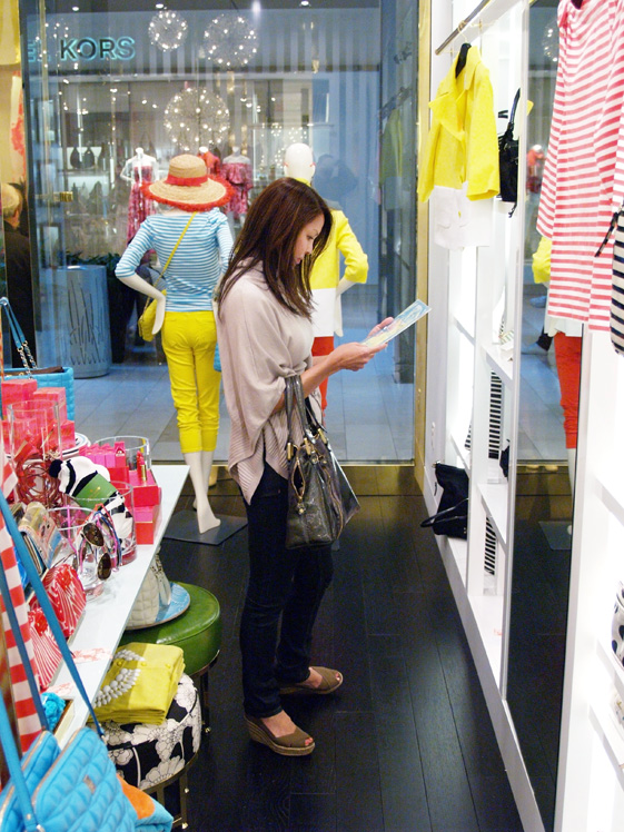 Customer inspecting Kate Spade stationary