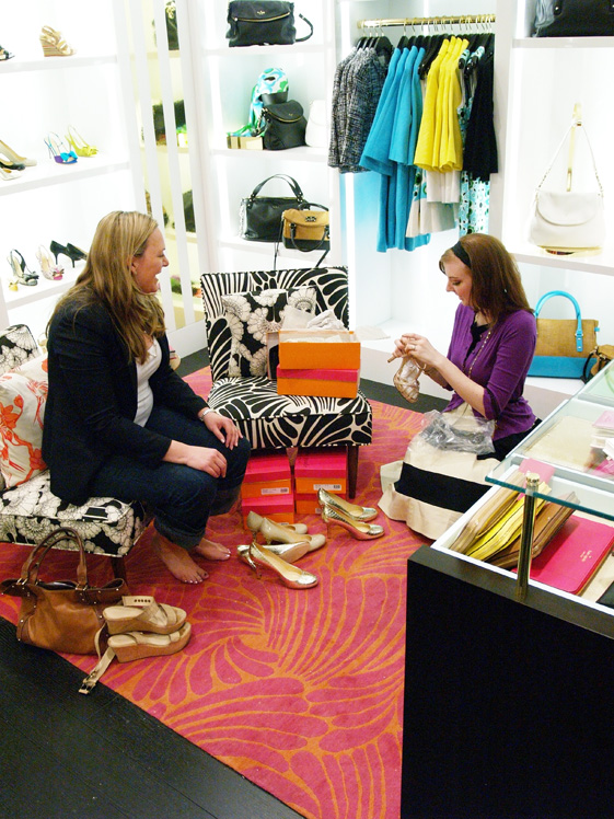 Kate Spade employee fitting customers shoes