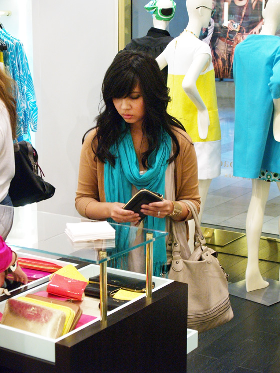 Kate Spade customer checking out wallets