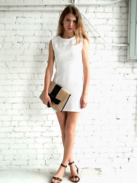 womens fold down clutch and white shift dress